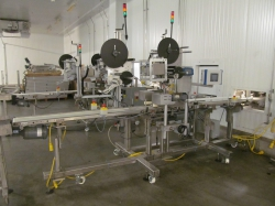 1 - WS Packaging Group, Inc. ASD50 LH Clamhell Tray Packaging Labeller