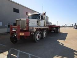 1 - Western Star 6900 XD Tandem Axel Winch Truck